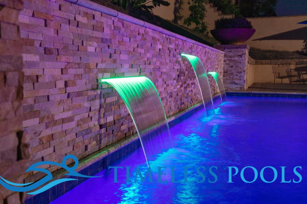 Rectangle pool with sheer descents of differing heights by Timeless Pools
